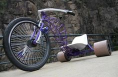 Drift trike. Never tried drifting but it looks like fun. Love the frame on this little purple beastie.