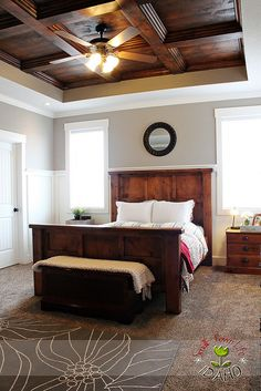pretty Master Bedroom with wood coffered ceiling