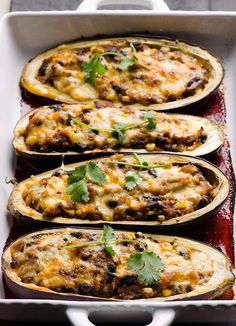Tex Mex Quinoa Stuffed Eggplant - Meaty eggplant stuffed with various vegetables, flavoured with spices and baked with cheese on top.