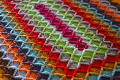 Oblong Wool Eater Blanket Patter by Sarah London.  English instructions can be found here:  http://sarahlondon.files.wordpress.com/2011/08/crocheted-wool-eater-blanket.pdf