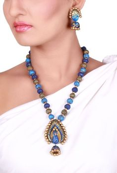 Peacock Terracotta necklace set Dimension of necklace: 11 inches Dimension of earrings: 2.5 inches Weight: 78 gms Color: Blue & golden Closure: Necklace: String, Earring: Metallic lock Material: Terracotta clay Finish: Hand-crafted Inspiration: Elements Of Nature