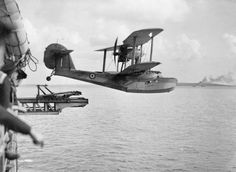 A Supermarine Walrus amphibian airplane being launched from the catapult deck of HMS Bermuda. The aircraft has just left the catapult. Navy Aircraft, Ww2 Aircraft, Military Aircraft, Aviation Image, Aviation Fuel, Float Plane, Flying Boat, Aircraft Design, Royal Air Force