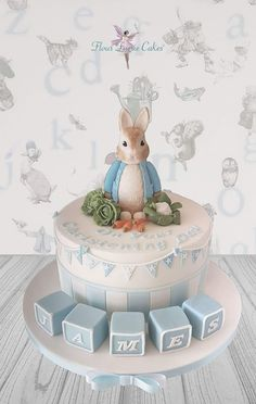 Peter Rabbit Cake Classic Madagascan vanilla cake with Strawberry and vanilla filling. All decorations are handmade and completely edible...
