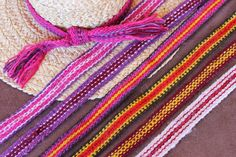 ASpinnerWeaver: Cochineal - The Red That Colored the World  Hatbands woven from New Mexico Wool, handspun and hand-dyed. Each band contains some cochineal-dyed yarn.  #inkleweaving