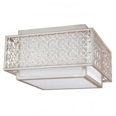 The transitional Kenney collection is an updated take on a classic, mid-century modern design in a sunset silver finish. This 2 light flush ceiling light features a square inner shade nestles within an intricate outer band of metal fretwork. The angular design makes this a contemporary option to instantly modernise any space. Perfect for homes with standard or low ceilings, this is ideal in living rooms, bedrooms, hallways and over dining tables.