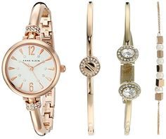 Anne Klein Women's AK/2338RGST Analog Japanese Quartz Rose Gold Watch. White textured dial with rose gold-tone hands and Swarovski crystal accented markers; rose gold-tone bangle accented with 28 clear Swarovski crystals; adjustable end links; jewelry clasp and extender. Set includes: 1 Swarovski crystal accented bangle; 1 chain bracelet with five white beads; 1 Swarovski crystal accented open bangle. Japanese-quartz Movement. Case Diameter: 26mm. Not water resistant.