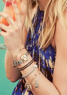 The wire bangles on this stacked wrist finish off the arm-candy perfectly.