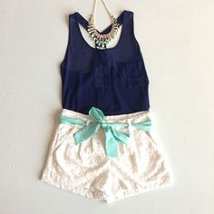 navy, white, and turquoise. bow and lace - cute but I can't do white shorts though. Change the shorts to navy and shirt to white and I'd be set.
