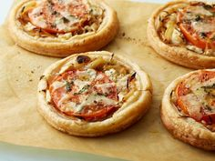 Recipe of the Day: Ina Garten's Tomato and Goat Cheese Tarts Topped with Parmesan and goat cheese, thyme-infused caramelized onions and tomato slices, these delectable morsels bake to golden, flaky perfection in the oven.