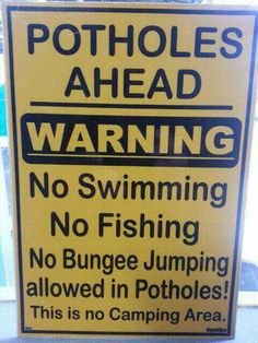 "No bungee jumping in the potholes?  Just how big are these ""potholes"" anyway??? [Sign near Fourways, Johannesburg, South Africa]"