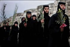 Orthodox nuns carry palm branches and crucifixes during the Palm Sunday procession. The ceremony is a landmark in the Christian calendar, marking the triumphant return of Jesus Christ to Jerusalem the week before his crucifixion, when a cheering crowd greeted him waving palm leaves. 2009.