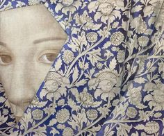 Love the design in the fabric, the face, and the blue background! Nice!  Vladimir DunjicVails, 2010