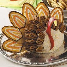 Too cute! This is a cute turkey cheeseball that is relatively easy to make to decorate the table!