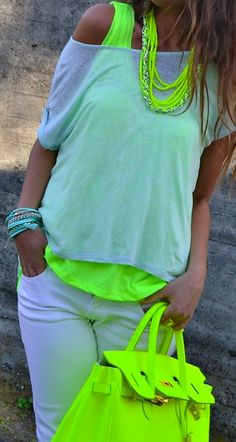not a big fan of neon, but i def like it better with white more than black.