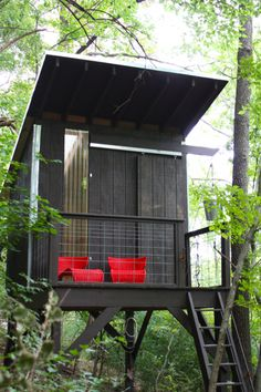 modern treehouse escape - my favorite treeless treehouse - could add a slide and/or rock climbing wall - could perch in the back right corner of the yard and use the retaining wall for support