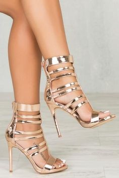 These rose gold heeled gladiator sandals are strapped to perfection, rocking cut-outs from the open toe all the way up the ankle. Covered stiletto heel provides