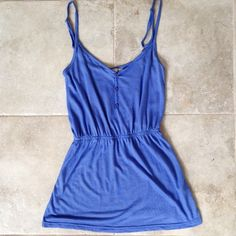 Rubbish striped tank top Blue and white striped tank top.  Size XS.  3 buttons on the front.  Adjustable straps.  Waist is gathered with elastic on the inside of the top.  Gently used.  Purchased at Nordstrom. Rubbish Tops Tank Tops