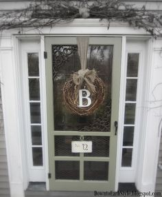 wooden screen door, take out the screen and have glass made for it. add iron accents and chicken wire along with house number