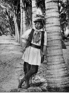 A Seminole Native American Man Wearing Native Seminole Clothing, Leaning Against A Palm Tree, Most Likely In Palm Beach, Florida. Native American Quotes, Native American History, Native American Indians, American Art, Cherokee Indians, American Symbols, American Pride, American Women, Cherokees