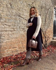 Turtleneck sweater, coat, pants and booties | For more style inspiration visit 40plusstyle.com