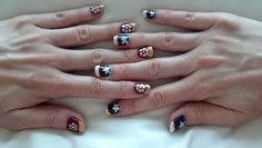 Nails at war: Marvel Civil War nails - Iron Man vs. Captain America, pinned from http://foresthouse.tumblr.com/post/29217501754/nails-at-war-marvel-civil-war-nails-iron-man