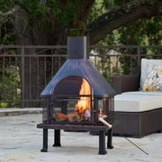 Gather the whole gang together for s'mores or curl up with a book next to this bronze outdoor fire pit. This vintage-style fire pit burns either charcoal or wood, and comes with a poker tool to adjust the fire's fuel from a distance.