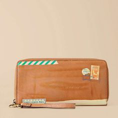 """Love this travel wallet from Fossil   Inscription says """"Wherever the wind takes you"""" <3"""