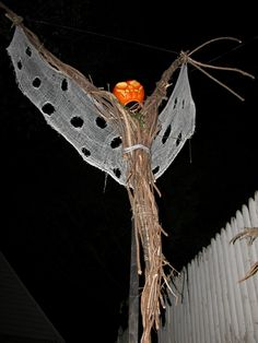 halloween scarecrow~ but done with a cooler piece of wood & much more cloth...