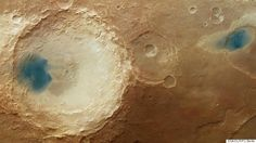Blue Spots On Mars Look Like Liquid Water--But are dark sediments that look like liquid water because of the way the image was processed.