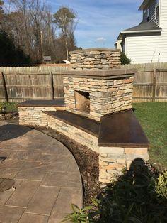 Beautiful DIY outdoor fireplace built using a www.backyardflare.com construction plan.  Backyard Flare, LLC