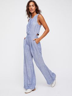 Lexington Wide Leg One-Piece | Wide leg one-piece featuring an easy,breezy linen fabrication with an open back detail and front button closures at the bust.      * Side pockets and faux back pocket details   * Elastic band at the back of the waist