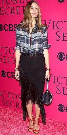 OLIVIA PALERMO A plaid button-down, a fringe midi, red lace-up heels and a fur purse. Only Olivia could get away with such an eclectic mix of trends, which she sports at the Victoria's Secret fashion show in N.Y.C.