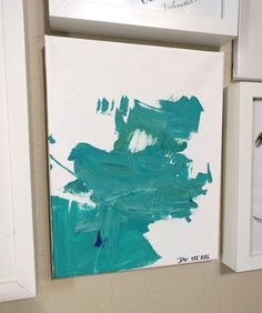 Cute idea for adding a little kid love to your home! This lovely canvas was painted by a 2-year-old and it's looks so pretty as part of the gallery wall.