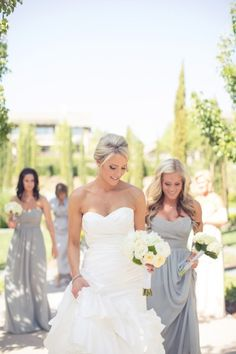 Never thought about grey bridesmaid dresses. But it's very pretty! And the brides dress too!