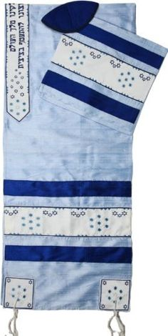 Turquoise Silk Tallit with Dark Blue Stripes and Stars of David on White by World of Judaica. $224.00. This turquoise silk Tallit features navy blue stripes and turquoise Stars of David on the sides, corners and Atara and has Hebrew text in the center on a white background. This turquoise blue silk Tallit is decorated with Stars of David in groups of seven and three as well as in scattered patterns on the sides, corners and edges of the Atara. The Tallit has Tzitzit attac...