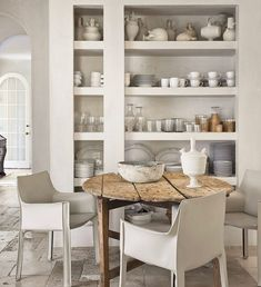 A collection of pottery and everyday china fills the kitchen shelves. Black Kitchens, Cool Kitchens, Beautiful Kitchens, Antique Farm Table, Craftsman Kitchen, Country Interior, Kitchen Shelves, Kitchen Flooring, Interior Design Kitchen