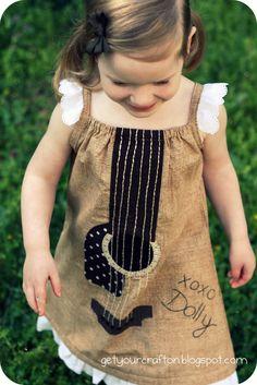 Guitar dress. This dress would be perfect for our girls since we both play the guitar! Thanks @Emmi Hartman