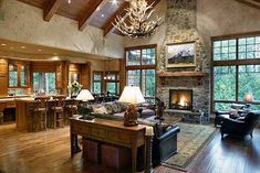 Wouldn't ever have a place like this but I do like the layout... Kitchen and great room open floor plan. Love the windows on either side of fireplace