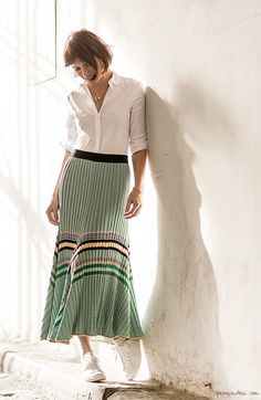 Sheherazade Goldsmith, style story, Paris apartment, Loquet London, green skirt, Céline; white shirt, COS; sneakers, Isabel Marant / Garance Doré