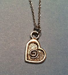 cochlea swirl heart necklace. Other audiology jewelry at link
