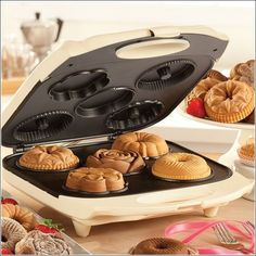 Baking donuts and mini cakes is easier than ever with the Bella Fluted Cake Maker! This compact machine bakes five beautiful cakes in minutes. Each of the cakes are a different design - ranging from basic bundt shapes to delicate flowers. Cool Kitchen Gadgets, Cool Kitchens, Kitchen Stuff, Cake Makers, Cooking Gadgets, Cool Inventions, Mini Cakes, Finger Food, Food And Drink