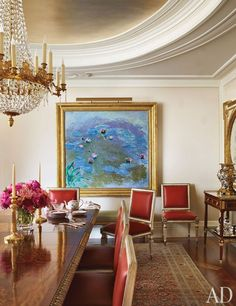 Michael S. Smith - a Monet water lily painting graces the antiques filled dining room of a NYC apartment.