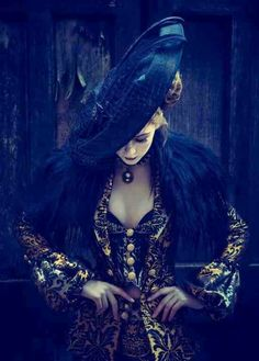 Golden satin blazer dress flocked w/ black floral print & matching waistcoat over barely visible black bustier, faux black fur shawl, black Ferris Wheel hat, choker w/ pendant, blonde mushroom cloud ~ Capitol Couture Collection steampunk / Victorian