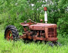 Google Image Result for http://www.todaysphoto.org/potd/rusty-old-tractor.jpg