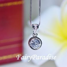20% Holiday Sales!!! This beautiful necklace showcases a 1 carat bezel-set, round brilliant-cut man made diamond simulant. Crafted in 925 sterling silver, this pendant hangs from a graceful cable chain. Includes a gift box. Handmade in Hong Kong. #Holidaysales #blackfriday2020 #discount #sales #gifts #holidaygifts #ChristmasGift #everydaynecklace #BridesmaidGift #weddinggifts #necklace #1carat #sterlingsilverjewelry