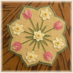 """Prim Wool Felt. This kit contains all of the Merino wool blend felt you will need to complete this 13"""" candle mat. Add these colorful Tulips and Daffodils to your home decor with this Spring Blossoms design. 