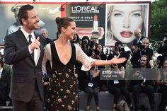 British actor Michael Fassbender and Swedish actress Alicia Vikander pose on the…