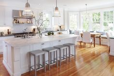 this is so dreamy. the stools, the island, subway tiles, the comfy bench...love.