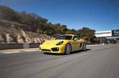 2014 Porsche Cayman S front three quarters in motion