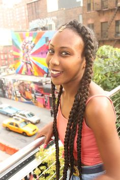 Natural hair - braided styles! nice smile ,nice view good photograph.